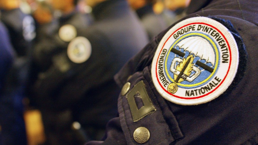 A file picture shows the logo of the National Gendarmerie Intervention Group
