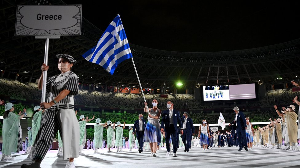 Flag bearers Anna Korakaki and Eleftherios Petrounias of Team Greece lead their team in during the Opening Ceremony of the Tokyo 2020 Olympic Games at Olympic Stadium on July 23, 2021 in Tokyo, Japan.