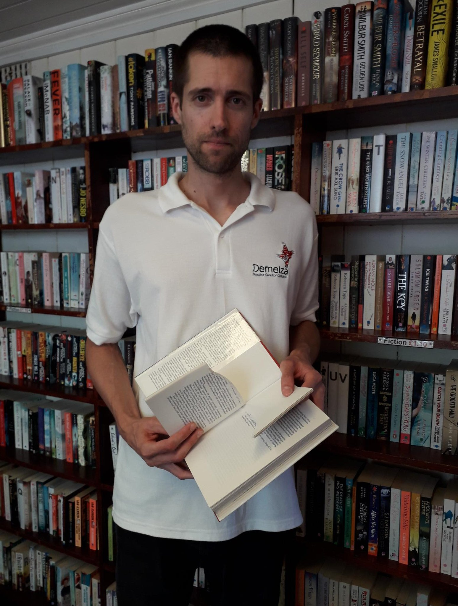Bookshop manager Nick Rogers with one of the torn books