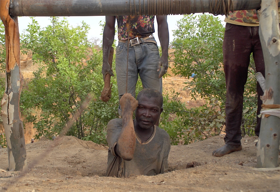 A miner being lowered into a mine at Barkin Ladi