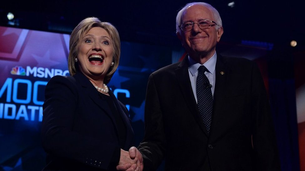 US Democratic presidential candidates Hillary Clinton and Bernie Sanders shake hands before participating in the MSNBC Democratic Candidates Debate at the University of New Hampshire in Durham