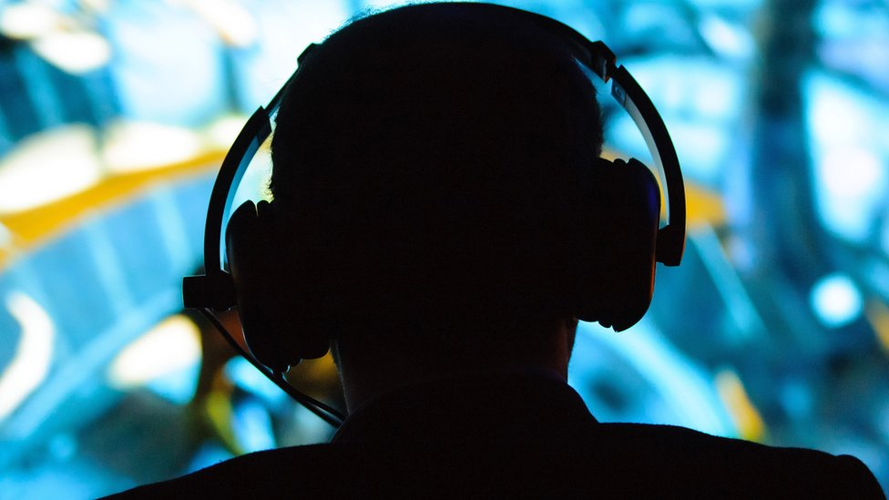 Silhouette of a man wearing headphones