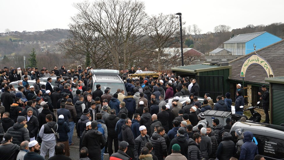 The coffin of Mohammed Yassar Yaqub is carried outside Masjid Bilal Huddersfield