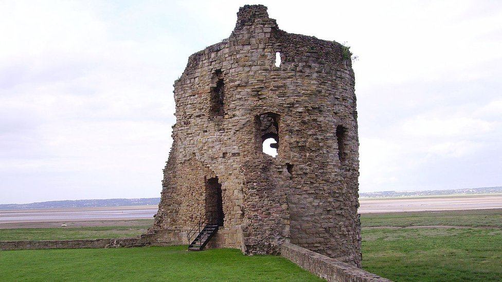 A tower section of Flint Castle overlooking the Dee estuary