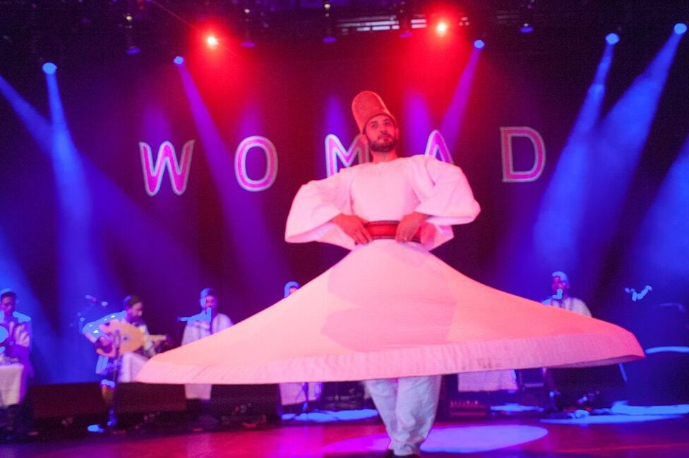 "A whirling dervish dances himself dizzy while Noureddine Khourchid, accompanied by six other Syrian singer-musicians, performs a series of sacred Sufi songs known as ""inshads""."