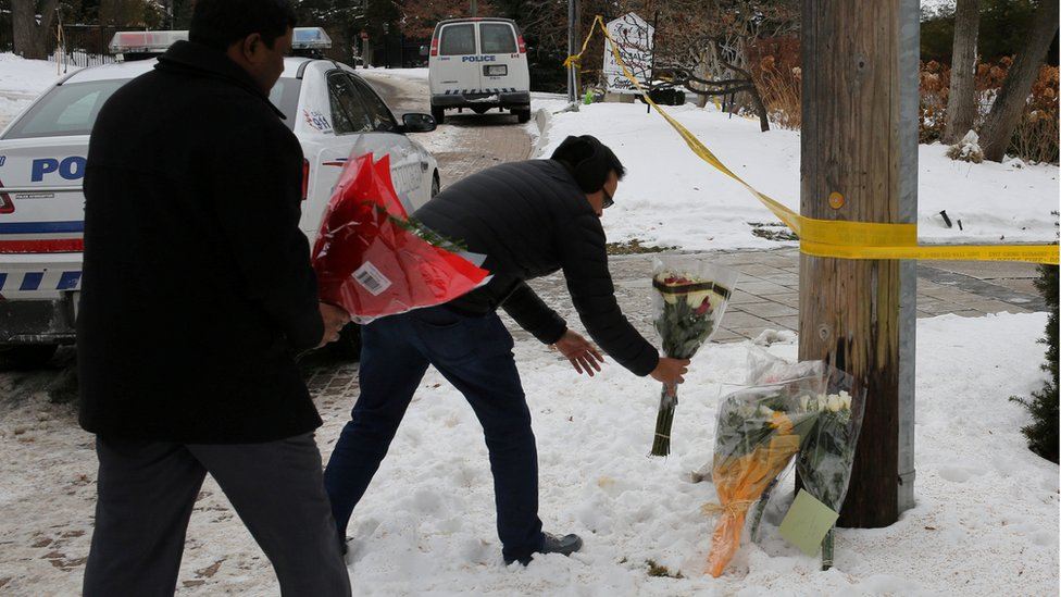 "Mourners place flowers outside the home of billionaire founder of Canadian pharmaceutical firm Apotex Inc., Barry Sherman and his wife Honey, who were found dead under circumstances that police described as ""suspicious"", in Toronto, Ontario, Canada, December 17, 2017"