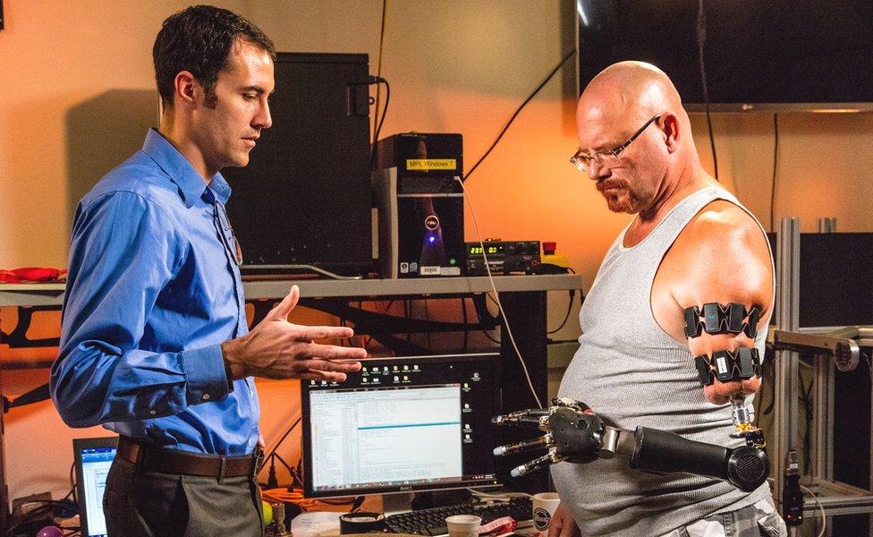 Johnny Matheny tries out his Myo prosthetic hand at John Hopkins University Applied Physics Lab