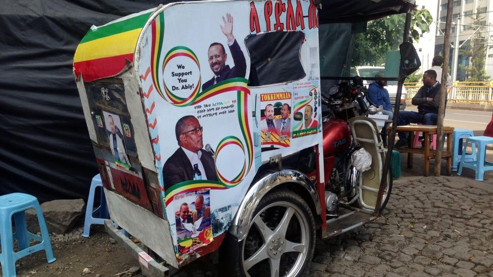 Posters of Ethiopian Prime Minister Abiy Ahmed are seen on a tuc-tuc in Addis Ababa, Ethiopia on November 07, 2018