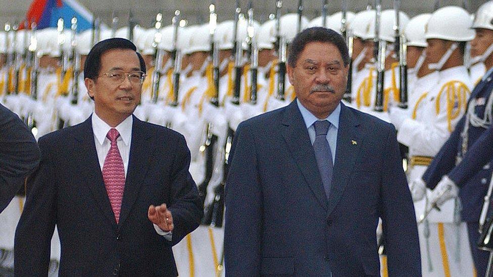 Sao Tome and Principe President Fradique Bandeira Melo de Menezes (R), accompanied by then Taiwan President Chen Shui-bian