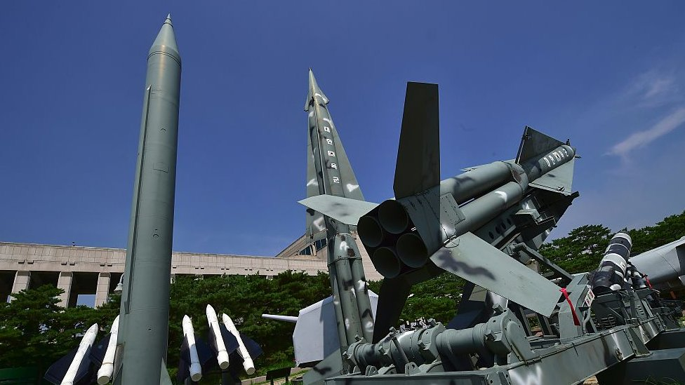 Replicas of a North Korean Scud-B missile (L) and South Korean Nike missiles are displayed at the Korean War Memorial in Seoul on July 19