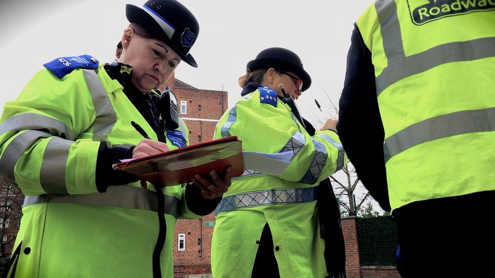 Police community support officers record registration details