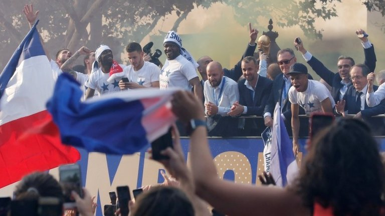 France's World Cup team given heroes' welcome in Paris