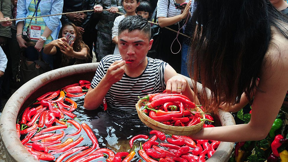 A contestant takes part in a chilli pepper-eating competition in China