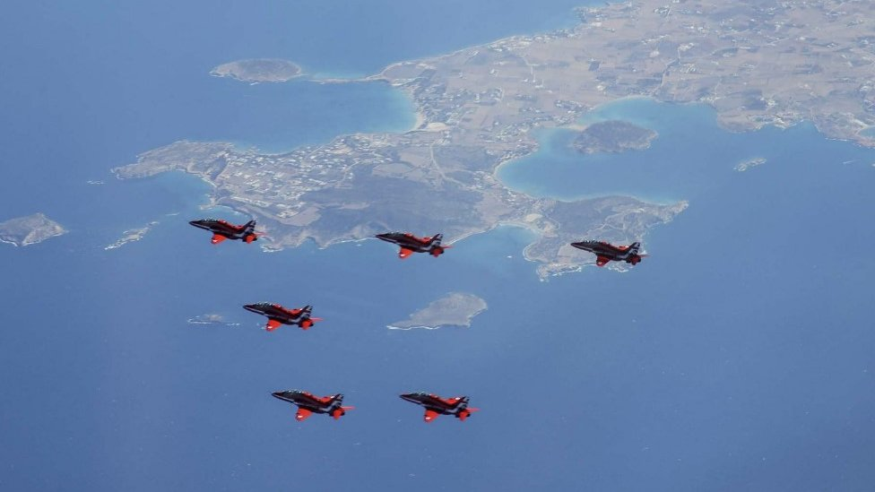 Red Arrows in formation over Greek islands