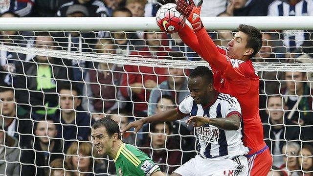 West Brom's Saido Berahino challenges Sunderland goalkeeper Costel Pantilimon