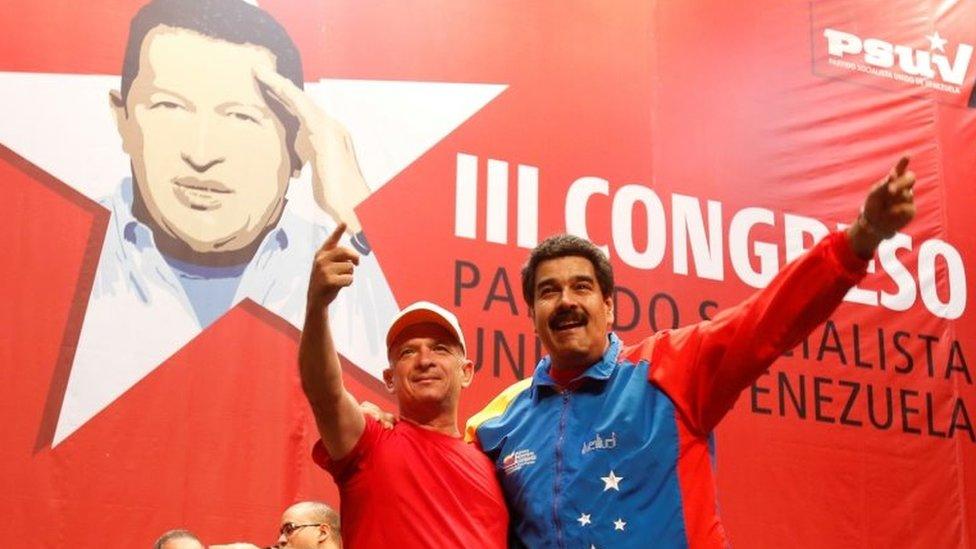 "Venezuela""s President Nicolas Maduro (R) embraces retired General Hugo Carvajal as they attend the Socialist party congress in Caracas, Venezuela July 27, 2014."