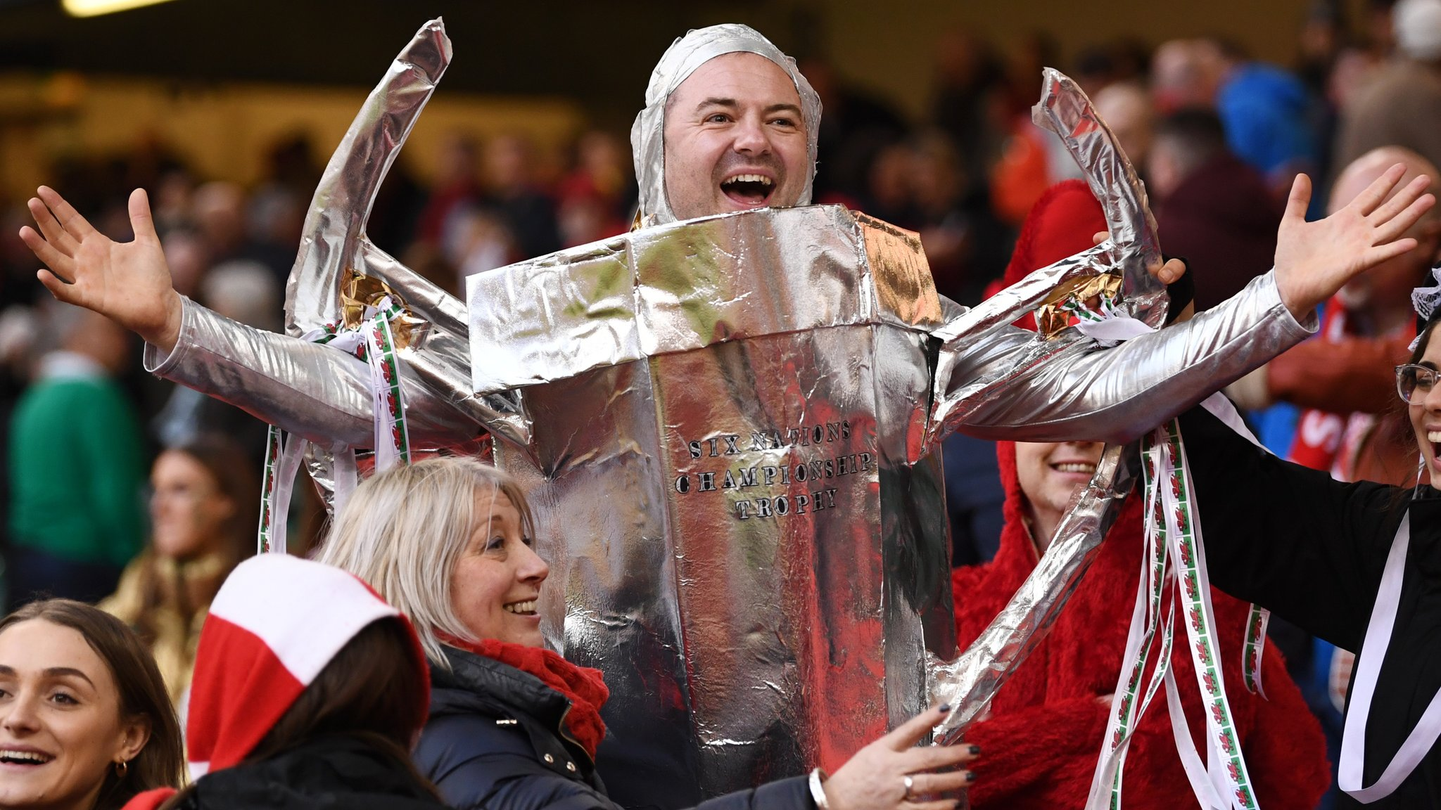 Six Nations: As the rain poured down in Cardiff, so did beers of joy