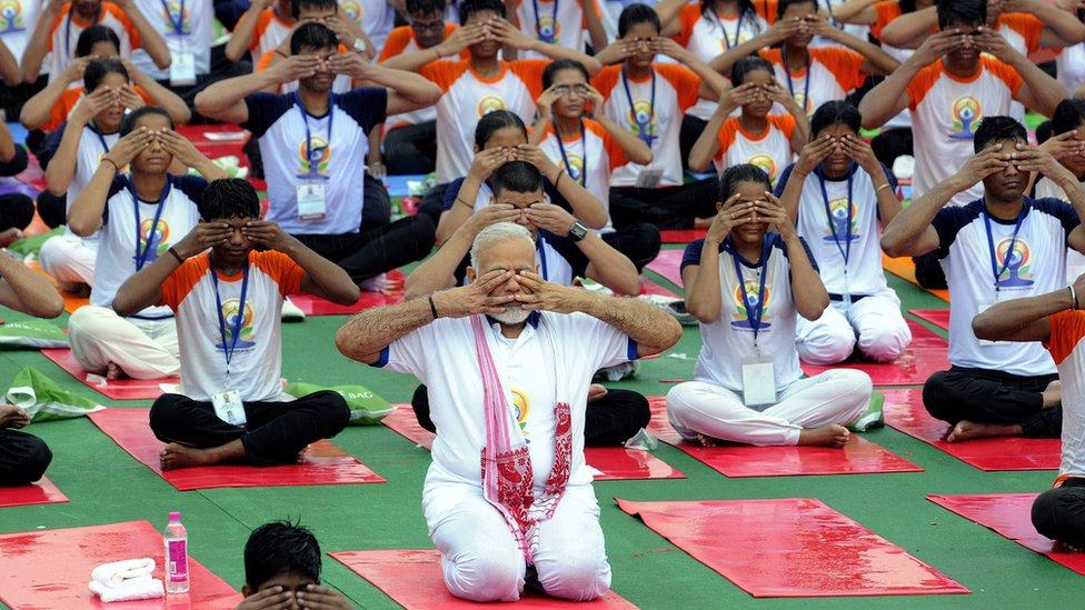 Indian Prime Minister Narendra Modi performs yoga to mark the international Day of Yoga, in Lucknow, Uttar Pradesh, India 21 June 2017