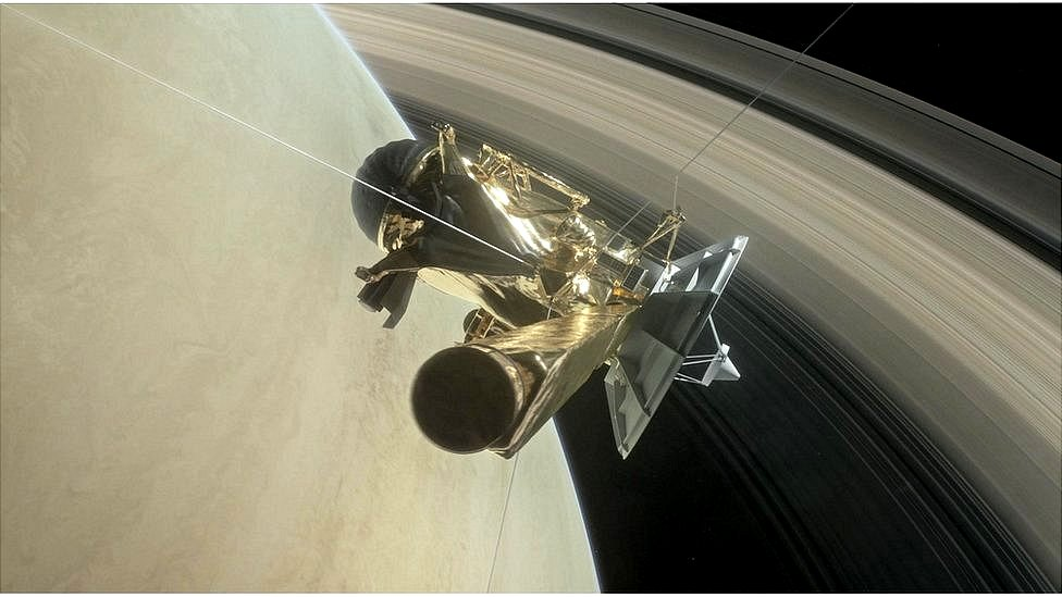 Artwork: Cassini is running the narrow gap between the top of the planet's atmosphere and the rings