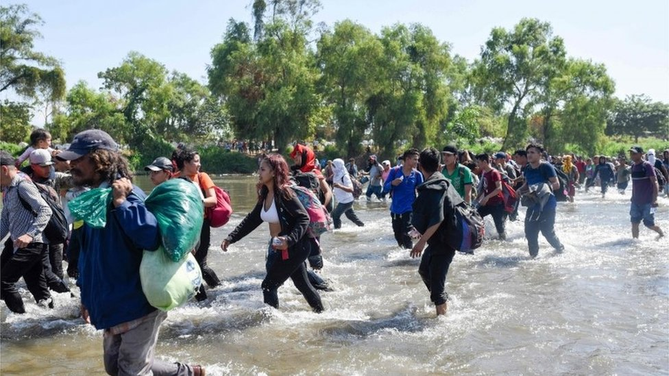 Migrants cross the Suchiate river at the border between Guatemala and Mexico in a bid to get to the US, 20 January 2020