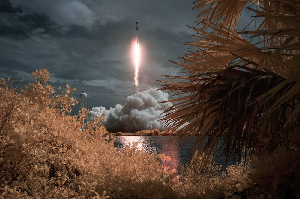 SpaceX Falcon 9 rocket carrying the Crew Dragon spacecraft launches in the distance
