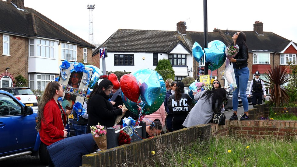 Friends and relatives of Henry Vincent bring birthday tributes to the scene on South Park Crescent in Hither Green