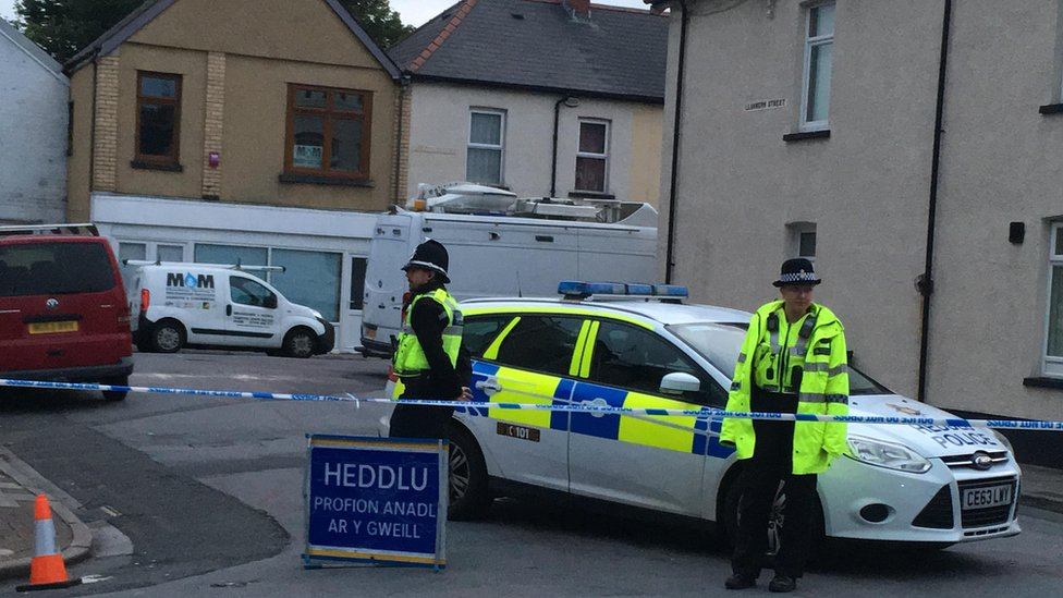 Police officers at the cordon on Jeffrey Street in Newport