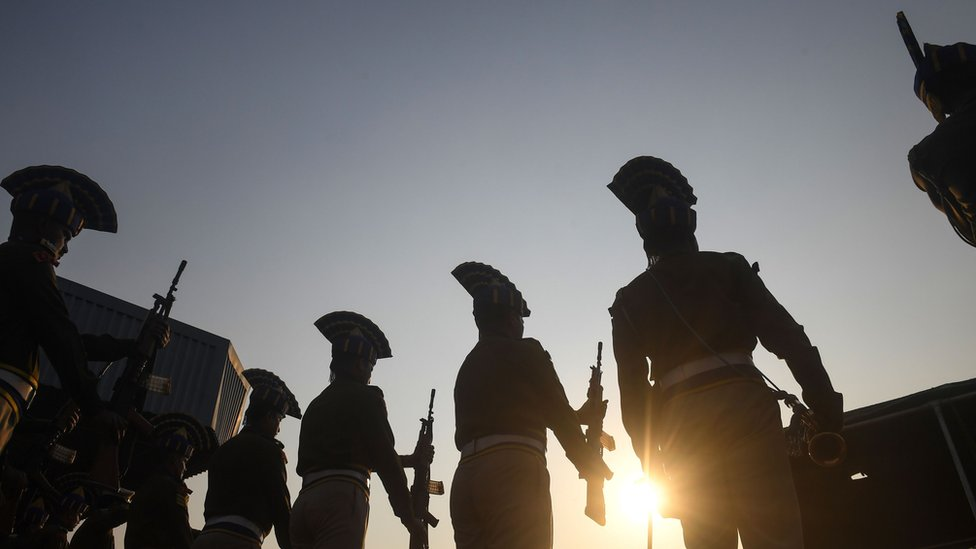 Indian Central Reserve Police Force (CRPF) personnel stand as a guard of honour for colleagues Sudip Biswas and Bablu Santra at Kolkata airport