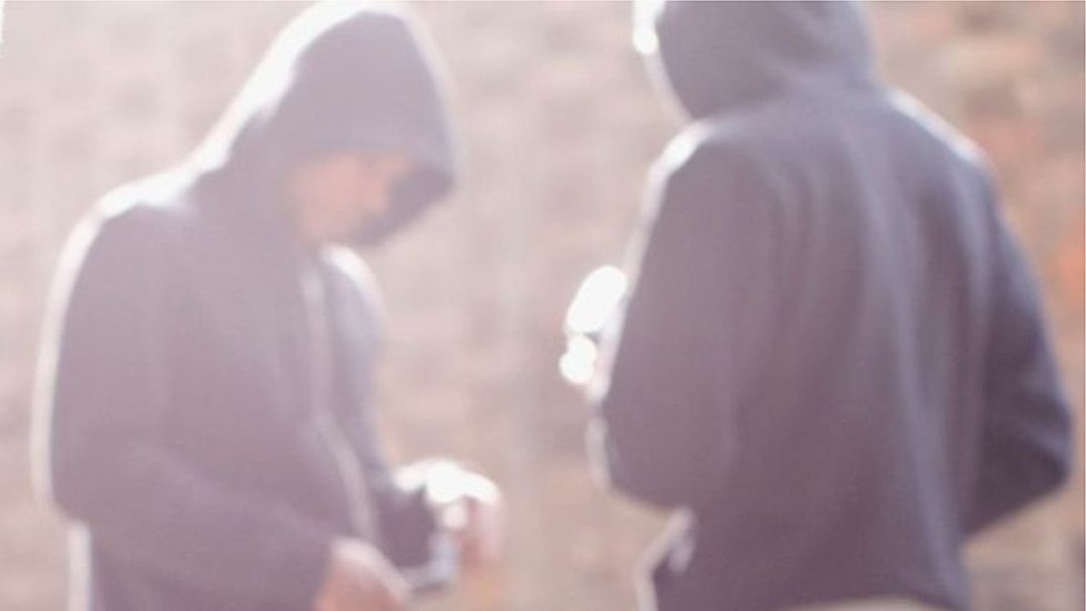 Blurred image of gang members