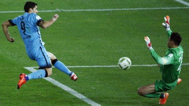 Barcelona's Luis Suarez scores against Guangzhou Evergrande