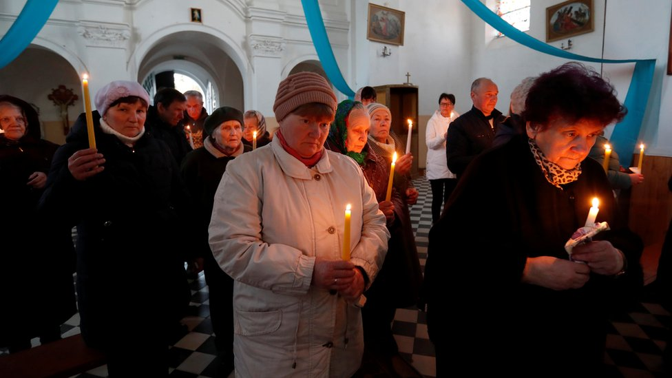 People attend a service on the eve of Catholic Easter, amid the coronavirus disease (COVID-19) outbreak, in the village of Dvorets, Belarus