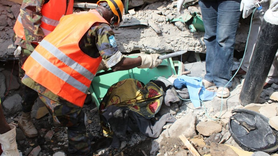 Rescuers trying to dig the woman out