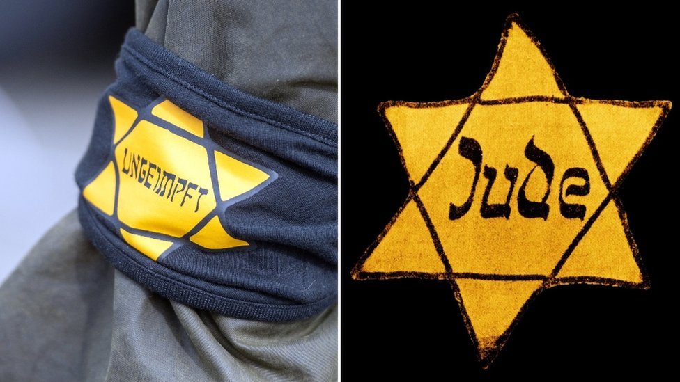 A Berlin protester wore a yellow star with the word