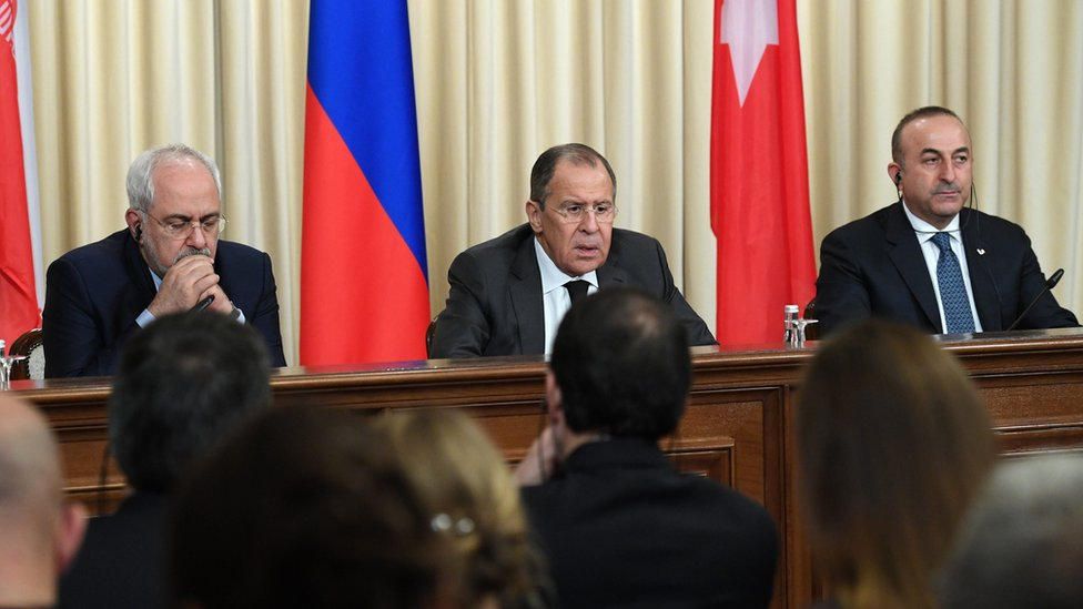 Iranian Foreign Minister Mohammad Javad Zarif, Russian Foreign Minister Sergei Lavrov and Turkish Foreign Minister Mevlut Cavusoglu attend a press conference in Moscow, Russia (20 December 2016)