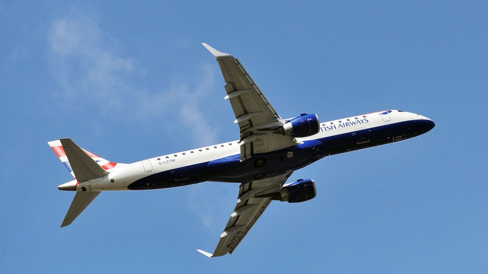 A British Airways passenger jet against a blue sky