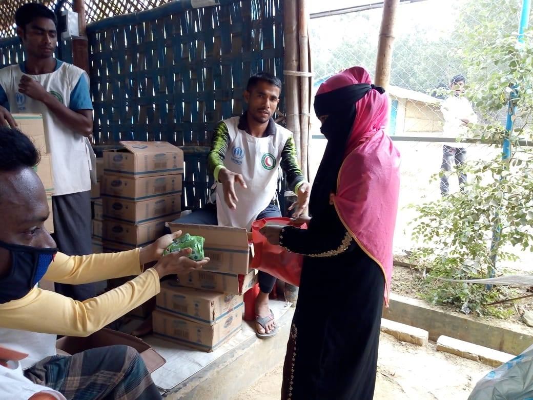 A woman receives soap distributed by an NGO