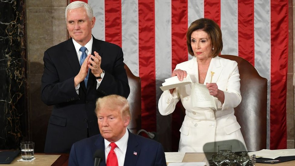 US Vice President Mike Pence claps as Speaker of the US House of Representatives Nancy Pelosi rips a copy of US President Donald Trump speech