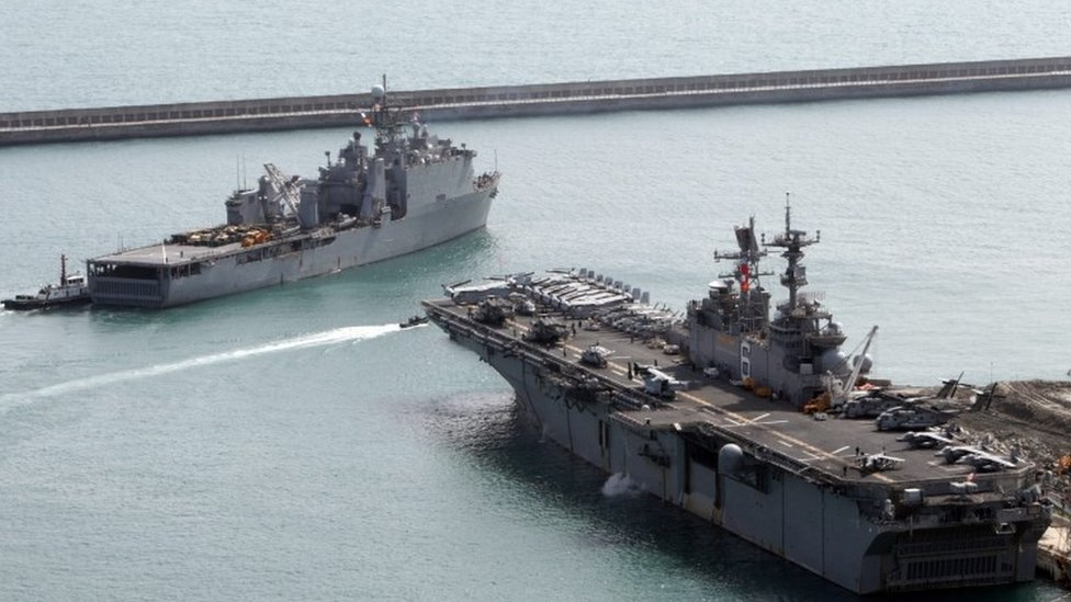 The amphibious assault vessel USS Bonhomme Richard (right) and the USS Ashland leave the south-eastern port of Busan, South Korea (07 March 2016)