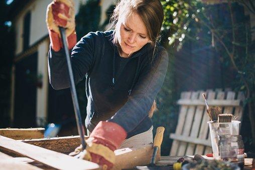 Woman doing DIY in backyard