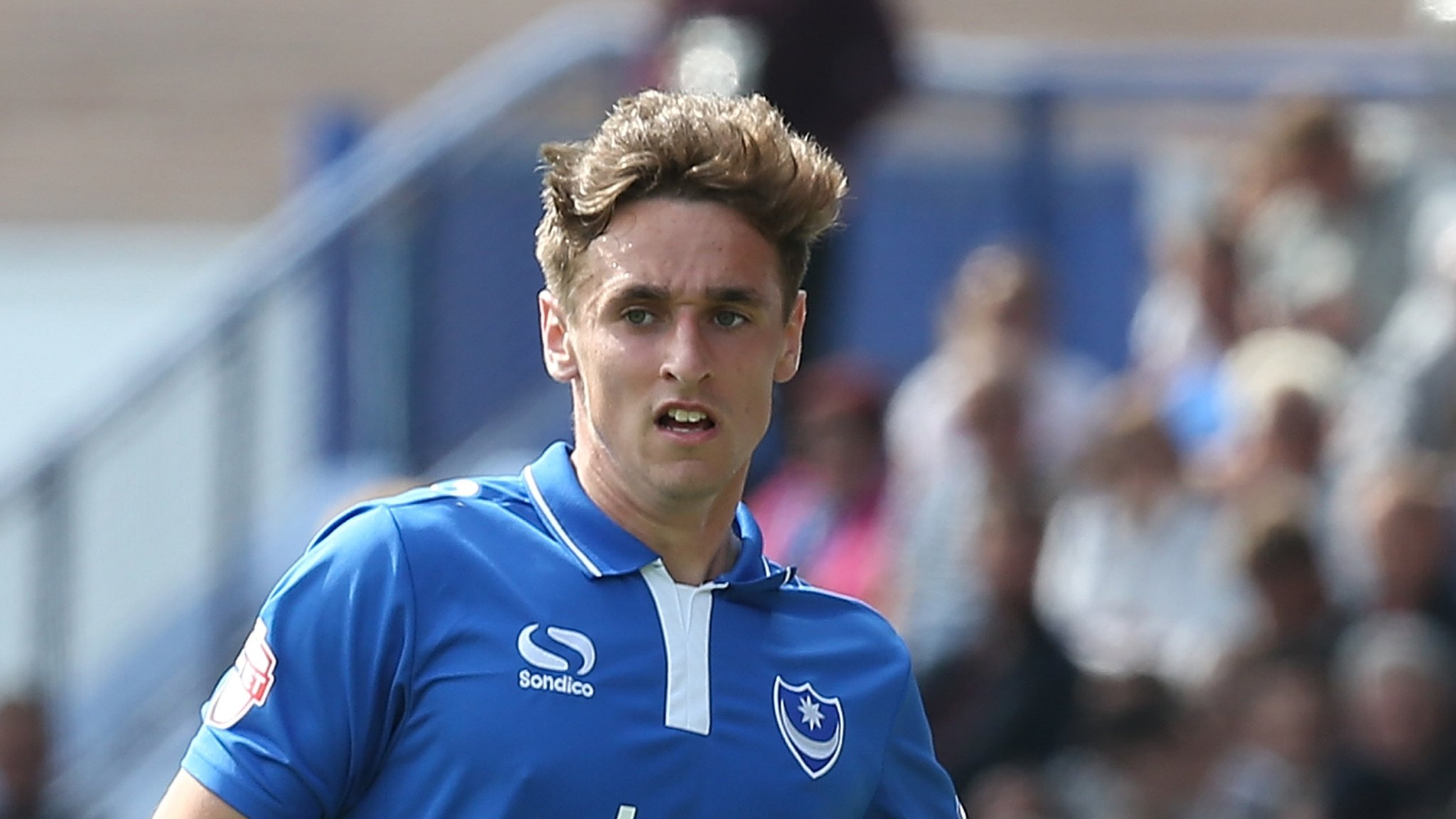 Brandon Haunstrup: Portsmouth defender signs new deal