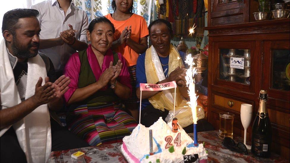 Lakpa Jangmu Sherpa (C) and Kami Rita Sherpa (R) at home with their family