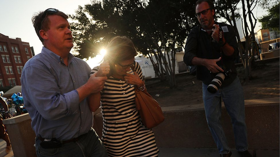 News photographer at Dallas shooting