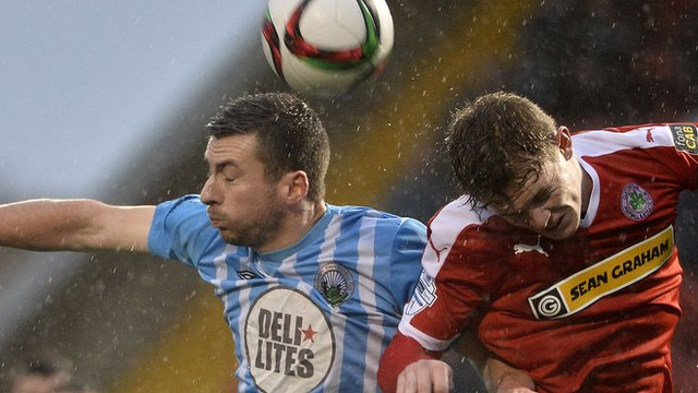 Action from Cliftonville against Warrenpoint Town