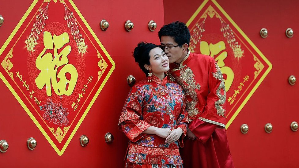 A couple dressed in traditional Chinese costumes have wedding portraits made on Valentine's Day 14 February 2013 in Beijing, China.