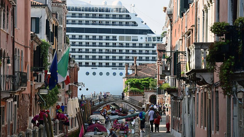 Cruise ship MSC Magnifica is seen from one of the canals leading into the Venice Lagoon on 9 June 2019 in Venice.
