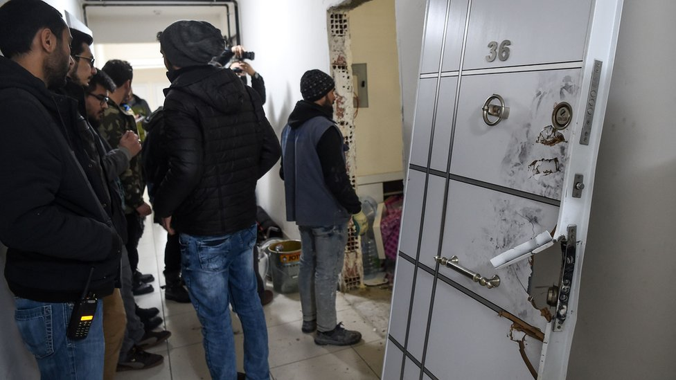 The door of a building where the alleged attacker of Reina nightclub was caught by Turkish police in Esenyurt area of Istanbul, Turkey, 17 January 2017