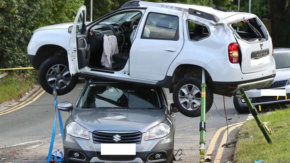 Newport crash leaves car balanced on top of another