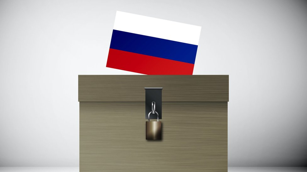Russian flag being put into a ballot box