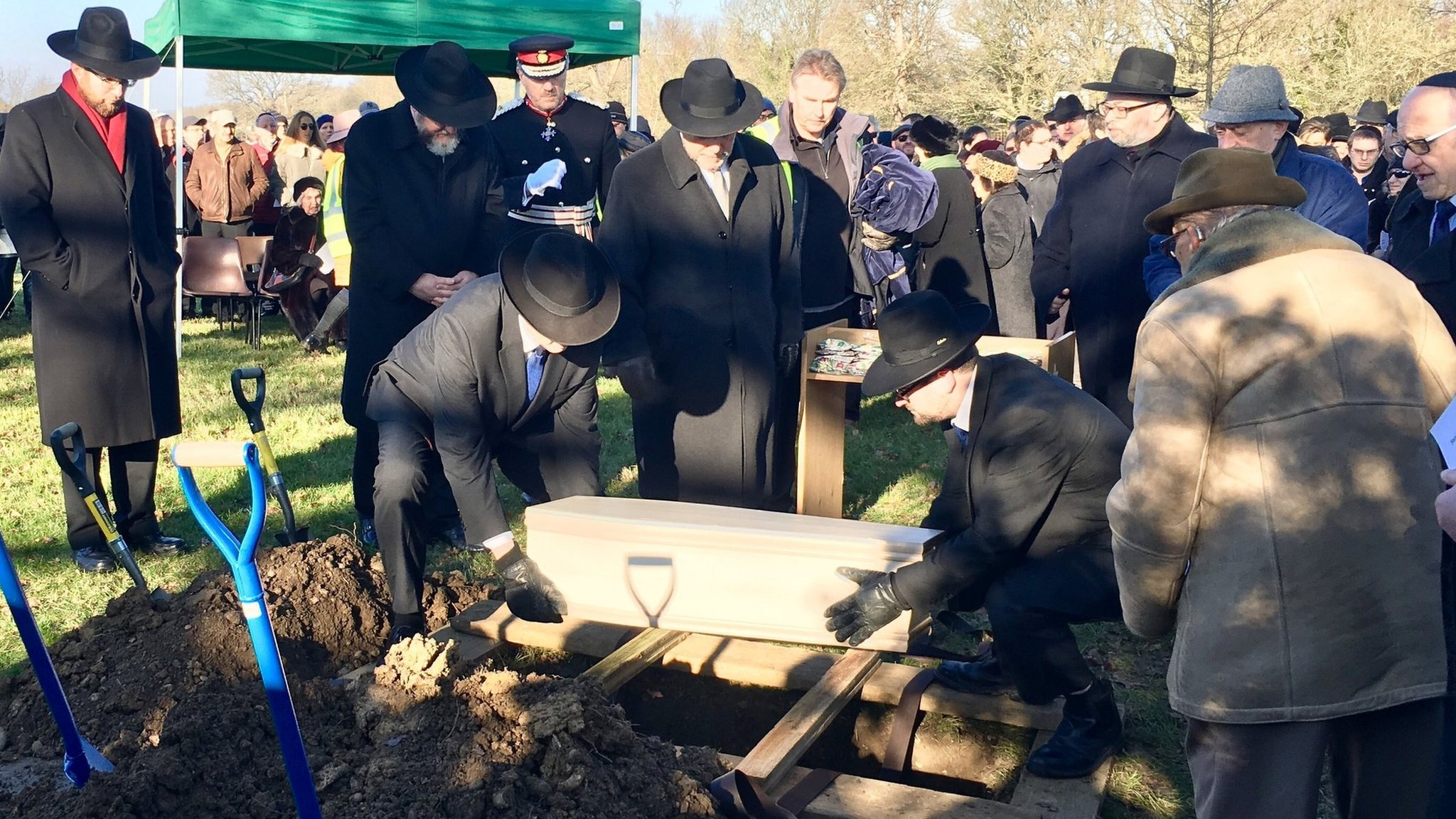 Holocaust victims funeral a reminder to 'confront racism'