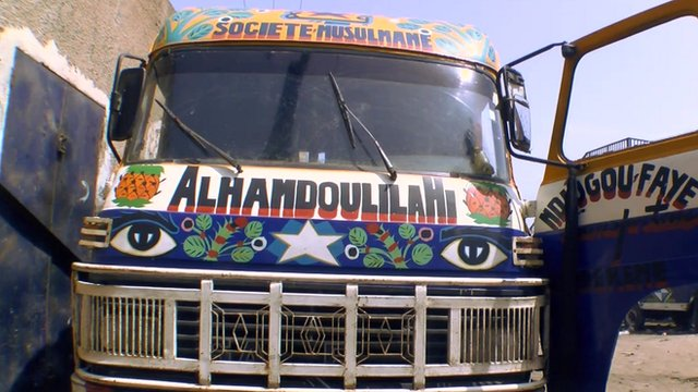 """Close up of a brightly-painted """"car rapide"""" in the Senegalese capital, Dakar"""